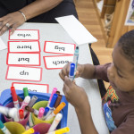 Preschool Child learning to write at the Learning Centers Early Childhood Program